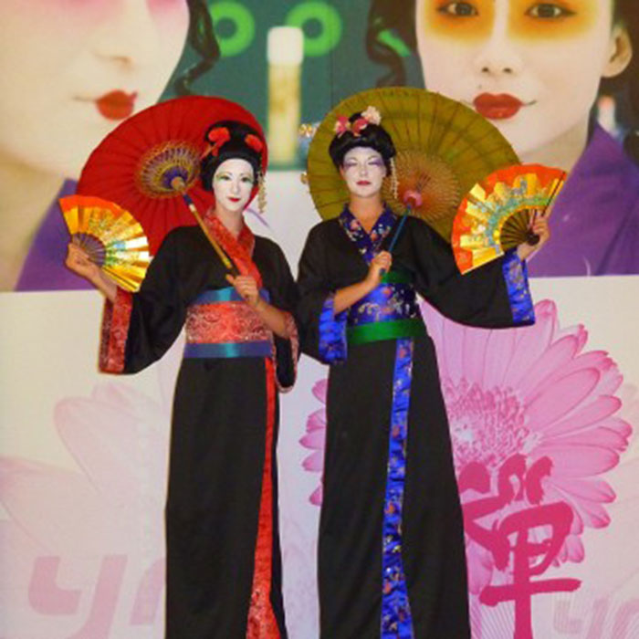 geishas stilt walking act