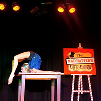Mad hatter contortionist act